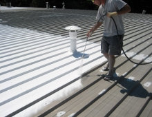 Spray-Application-of-White-Acrylic-Elastomeric-Coating-System-to-Metal-Roof-in-Winston-Salem-NC