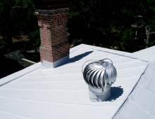 White-Acrylic-Elastomeric-Coating-System-Applied-to-Historical-Home-to-Stop-Leaks-to-this-Metal-Roof-in-Wilmington-NC
